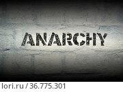 Anarchy stencil print on the grunge white brick wall. Стоковое фото, фотограф Zoonar.com/Yury Zap / easy Fotostock / Фотобанк Лори