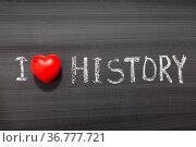 I love history phrase handwritten on the school blackboard. Стоковое фото, фотограф Zoonar.com/Yury Zap / easy Fotostock / Фотобанк Лори