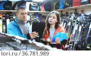Smiling family in sport equioment are choosing modern ski in sport store. Стоковое видео, видеограф Яков Филимонов / Фотобанк Лори