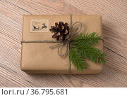 Christmas or New Year gift boxes wrapped in kraft paper with fir branch... Стоковое фото, фотограф Zoonar.com/Valery Kraynov / easy Fotostock / Фотобанк Лори