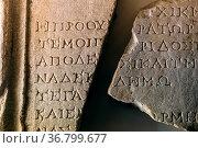 Ancient Greek text curved on broken stone tablet. Стоковое фото, фотограф Zoonar.com/Yury Zap / easy Fotostock / Фотобанк Лори