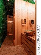 Rustic Toilet - wood style concept. green gras. Стоковое фото, фотограф Zoonar.com/konstantinmalkov.com / easy Fotostock / Фотобанк Лори
