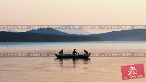 05-08-2020 KAZAN, RUSSIA: three men sitting in the boat on river - beautiful landscape of mountains and river. Редакционное видео, видеограф Константин Шишкин / Фотобанк Лори