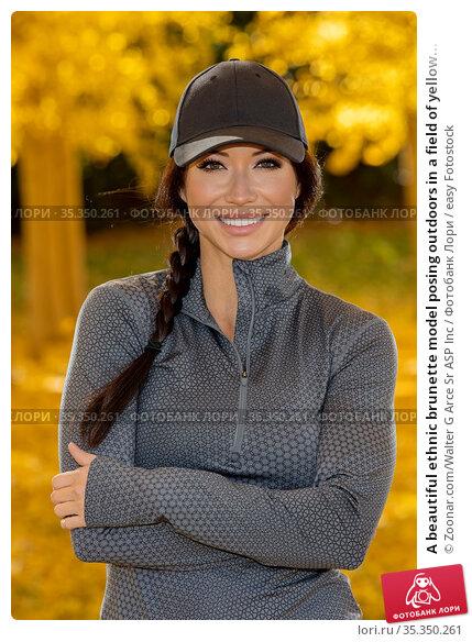 A beautiful ethnic brunette model posing outdoors in a field of yellow... Стоковое фото, фотограф Zoonar.com/Walter G Arce Sr ASP Inc / easy Fotostock / Фотобанк Лори