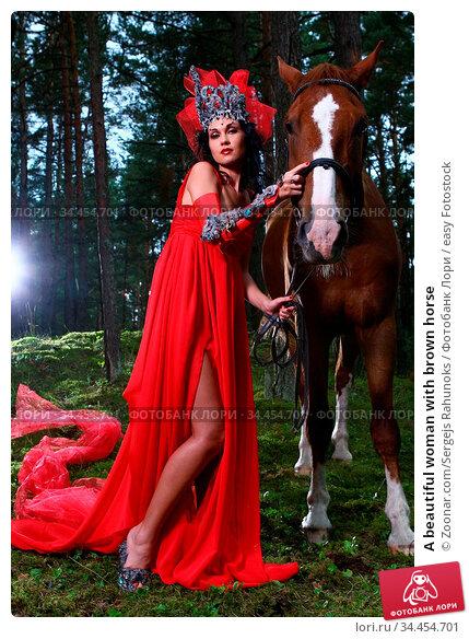 A beautiful woman with brown horse. Стоковое фото, фотограф Zoonar.com/Sergejs Rahunoks / easy Fotostock / Фотобанк Лори