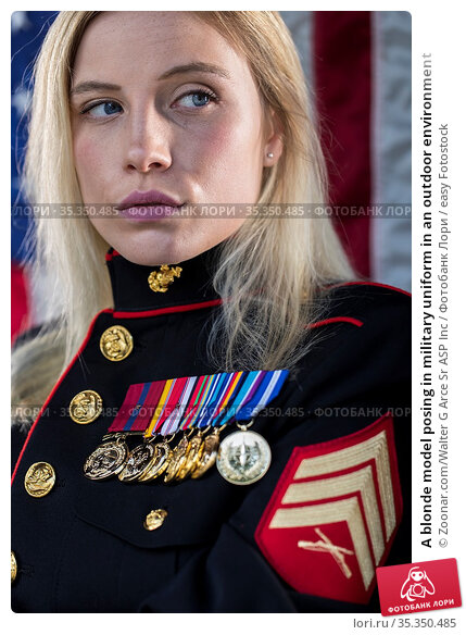 A blonde model posing in military uniform in an outdoor environment. Стоковое фото, фотограф Zoonar.com/Walter G Arce Sr ASP Inc / easy Fotostock / Фотобанк Лори
