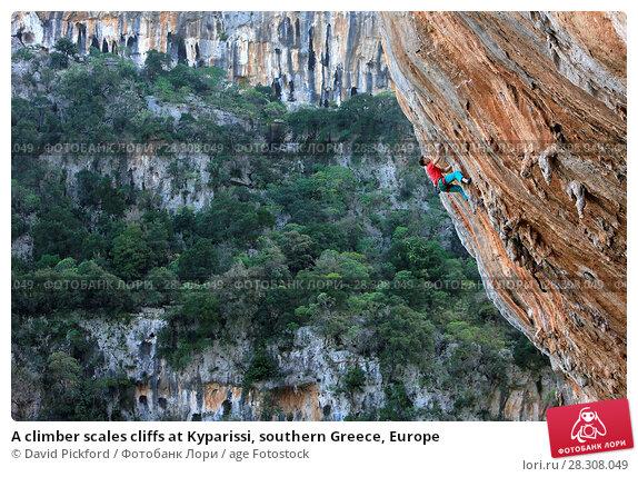 Купить «A climber scales cliffs at Kyparissi, southern Greece, Europe», фото № 28308049, снято 24 февраля 2017 г. (c) age Fotostock / Фотобанк Лори