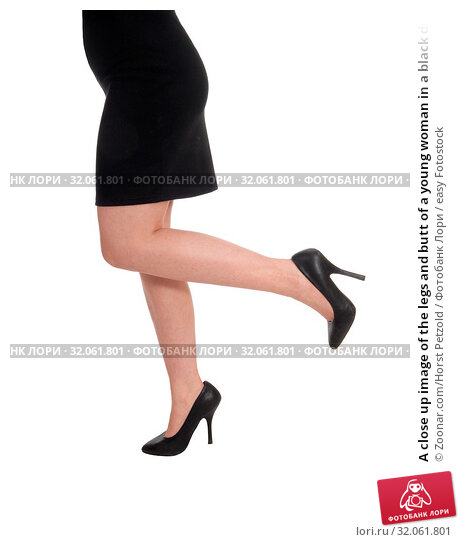 A close up image of the legs and butt of a young woman in a black dress and high heels, isolated for white background. Стоковое фото, фотограф Zoonar.com/Horst Petzold / easy Fotostock / Фотобанк Лори