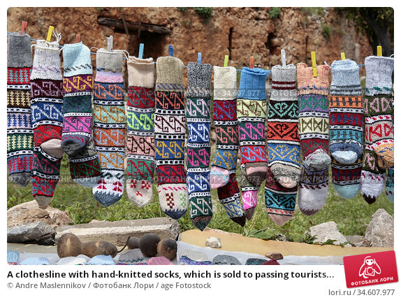 A clothesline with hand-knitted socks, which is sold to passing tourists... Стоковое фото, фотограф Andre Maslennikov / age Fotostock / Фотобанк Лори