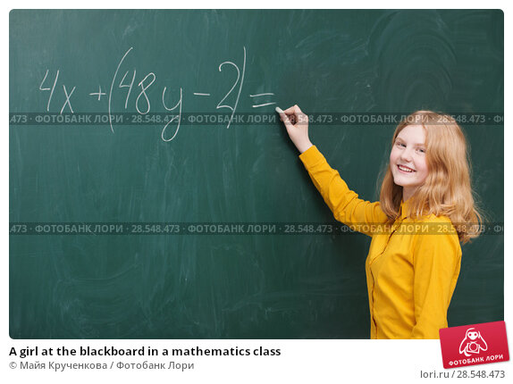 Купить «A girl at the blackboard in a mathematics class», фото № 28548473, снято 17 февраля 2018 г. (c) Майя Крученкова / Фотобанк Лори