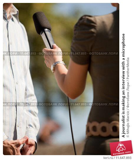 Купить «A journalist is making an interview with a microphone», фото № 11647893, снято 17 августа 2019 г. (c) PantherMedia / Фотобанк Лори