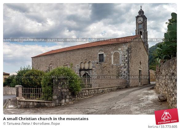 Купить «A small Christian church in the mountains», фото № 33773605, снято 12 сентября 2019 г. (c) Татьяна Ляпи / Фотобанк Лори