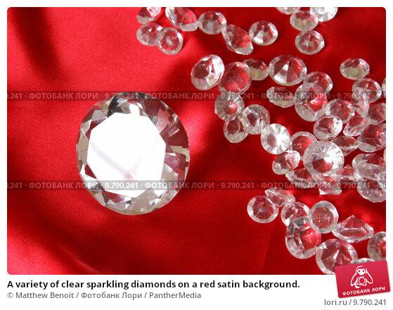 Купить «A variety of clear sparkling diamonds on a red satin background.», фото № 9790241, снято 18 февраля 2019 г. (c) PantherMedia / Фотобанк Лори