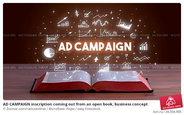 AD CAMPAIGN inscription coming out from an open book, business concept. Стоковое фото, фотограф Zoonar.com/ranczandras / easy Fotostock / Фотобанк Лори