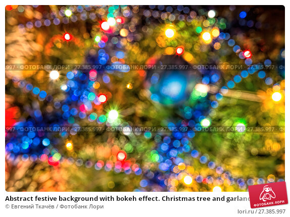 Купить «Abstract festive background with bokeh effect. Christmas tree and garlands of bright», фото № 27385997, снято 19 января 2016 г. (c) Евгений Ткачёв / Фотобанк Лори