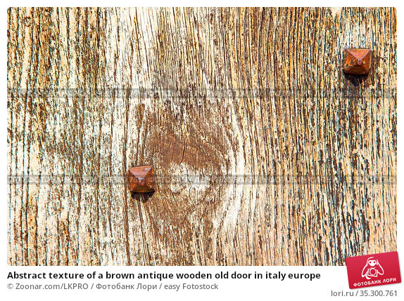 Abstract texture of a brown antique wooden old door in italy europe. Стоковое фото, фотограф Zoonar.com/LKPRO / easy Fotostock / Фотобанк Лори