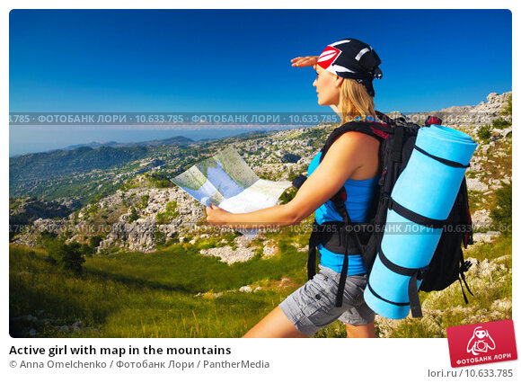 Купить «Active girl with map in the mountains», фото № 10633785, снято 18 апреля 2019 г. (c) PantherMedia / Фотобанк Лори
