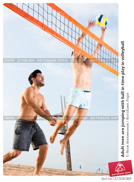 Купить «Adult men are jumping with ball in time play in volleyball», фото № 27029069, снято 6 сентября 2017 г. (c) Яков Филимонов / Фотобанк Лори