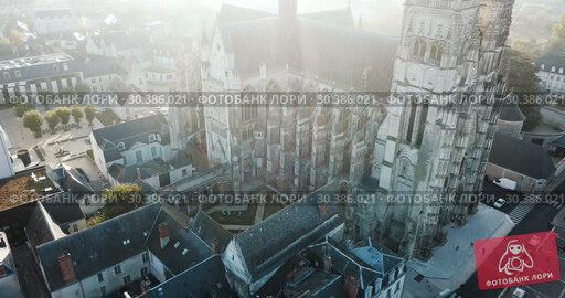 Купить «Aerial morning view of gothic Saint-Gatien Cathedral and city Tours, France», видеоролик № 30386021, снято 25 октября 2018 г. (c) Яков Филимонов / Фотобанк Лори
