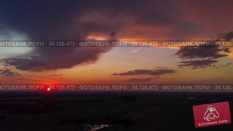 Купить «Aerial view from high attitude of sunshine dramatic sky», видеоролик № 34126473, снято 30 июня 2020 г. (c) Jan Jack Russo Media / Фотобанк Лори