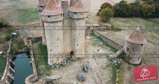 Купить «Aerial view of Chateau Sarzay – medieval castle in France», видеоролик № 30323069, снято 25 октября 2018 г. (c) Яков Филимонов / Фотобанк Лори