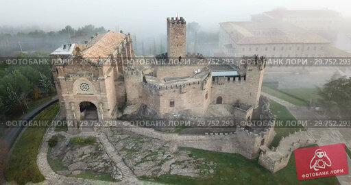 Купить «Aerial view of impressive medieval castle of Xavier with attached Basilica on hill in town of Javier, Navarre, Spain», видеоролик № 29752293, снято 23 декабря 2018 г. (c) Яков Филимонов / Фотобанк Лори