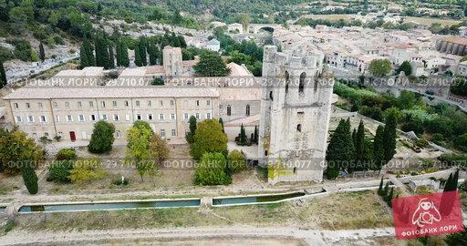 Купить «Aerial view of medieval Benedictine monastic complex of Saint Mary in French commune of Lagrasse», видеоролик № 29710077, снято 26 октября 2018 г. (c) Яков Филимонов / Фотобанк Лори