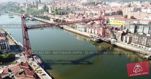 Купить «Aerial view of modern Vizcaya bridge crossing river at Portugalete, Spain», видеоролик № 32422001, снято 16 июля 2019 г. (c) Яков Филимонов / Фотобанк Лори