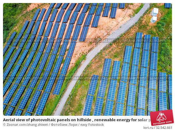 Купить «Aerial view of photovoltaic panels on hillside , renewable energy for solar power», фото № 32542661, снято 10 декабря 2019 г. (c) easy Fotostock / Фотобанк Лори