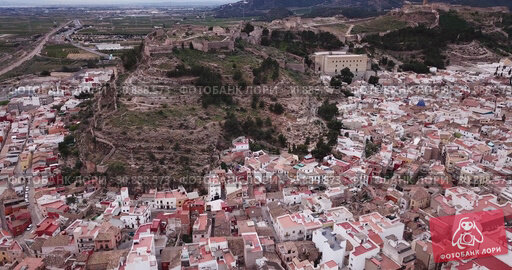 Купить «Aerial view of Sagunto city and antique roman fortress, Valencia, Spain», видеоролик № 30888573, снято 19 марта 2019 г. (c) Яков Филимонов / Фотобанк Лори