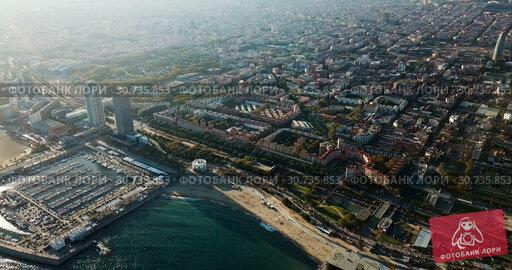 Купить «Aerial view of seaside area of Barcelona with harbor on sunny day, Catalonia, Spain», видеоролик № 30735853, снято 16 ноября 2018 г. (c) Яков Филимонов / Фотобанк Лори
