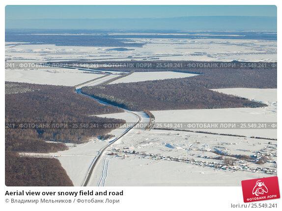 Aerial view over snowy field and road, фото № 25549241, снято 4 февраля 2017 г. (c) Владимир Мельников / Фотобанк Лори