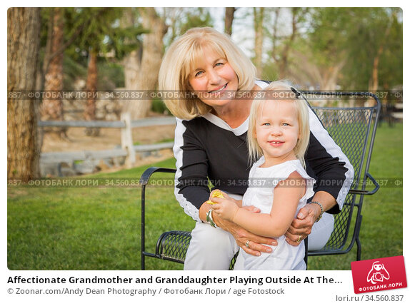 Affectionate Grandmother and Granddaughter Playing Outside At The... Стоковое фото, фотограф Zoonar.com/Andy Dean Photography / age Fotostock / Фотобанк Лори