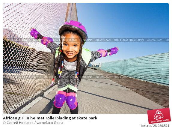 Купить «African girl in helmet rollerblading at skate park», фото № 28280521, снято 14 октября 2017 г. (c) Сергей Новиков / Фотобанк Лори