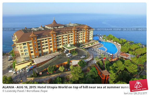 ALANIA - AUG 16, 2015: Hotel Utopia World on top of hill near sea at summer sunny day. Aerial view videoframe. Hotel Utopia World is a 5-star resort with total area of about 100000sq.m. Редакционное фото, фотограф Losevsky Pavel / Фотобанк Лори
