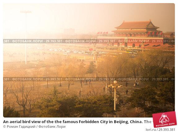 Купить «An aerial bird view of the the famous Forbidden City in Beijing, China. The vast area of the architectural complex», фото № 29393381, снято 14 января 2015 г. (c) Роман Гадицкий / Фотобанк Лори