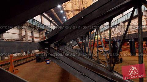 An overview of a big industrial construction plant. View from the iron part of the lifting crane. Стоковое видео, видеограф Константин Шишкин / Фотобанк Лори