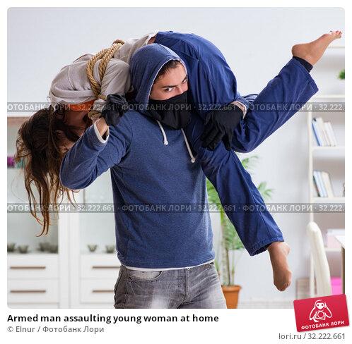Купить «Armed man assaulting young woman at home», фото № 32222661, снято 15 декабря 2017 г. (c) Elnur / Фотобанк Лори