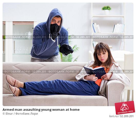 Купить «Armed man assaulting young woman at home», фото № 32289201, снято 15 декабря 2017 г. (c) Elnur / Фотобанк Лори
