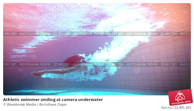 Athletic swimmer smiling at camera underwater, фото № 22991201, снято 27 июля 2017 г. (c) Wavebreak Media / Фотобанк Лори