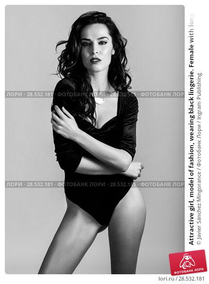 Купить «Attractive girl, model of fashion, wearing black lingerie. Female with long wavy hairstyle. Studio shot», фото № 28532181, снято 11 марта 2017 г. (c) Ingram Publishing / Фотобанк Лори