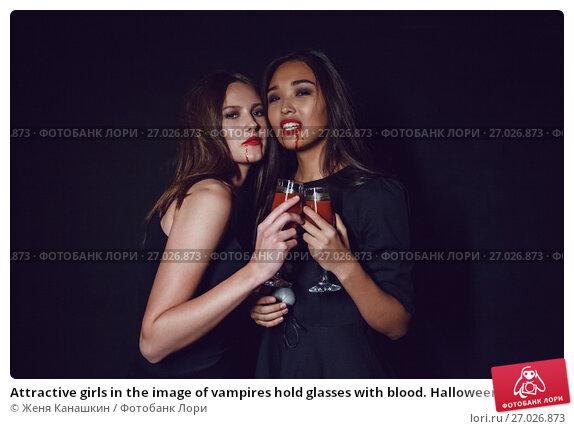 Купить «Attractive girls in the image of vampires hold glasses with blood. Halloween.», фото № 27026873, снято 22 сентября 2017 г. (c) Женя Канашкин / Фотобанк Лори