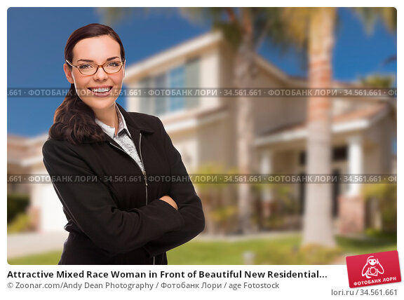 Attractive Mixed Race Woman in Front of Beautiful New Residential... Стоковое фото, фотограф Zoonar.com/Andy Dean Photography / age Fotostock / Фотобанк Лори