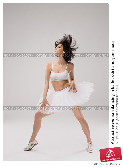 Attractive woman dancing in ballet skirt and gumshoes. Стоковое фото, фотограф Гурьянов Андрей / Фотобанк Лори