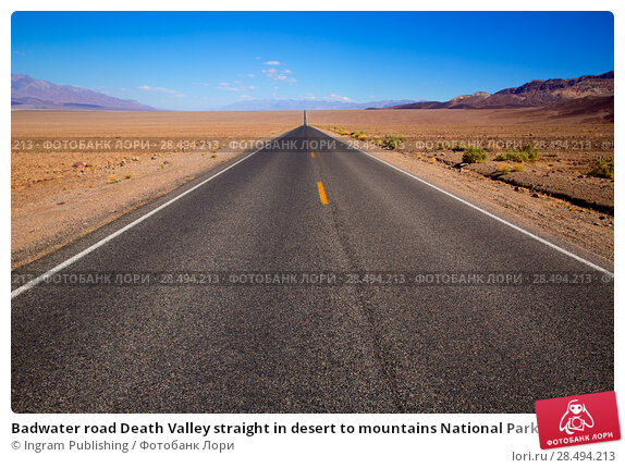 Badwater road Death Valley straight in desert to mountains National Park California. Стоковое фото, агентство Ingram Publishing / Фотобанк Лори
