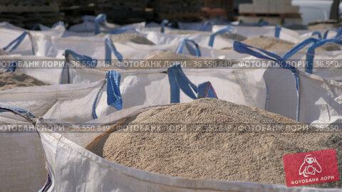Bags with bulk construction materials outdoors. Стоковое видео, видеограф Яков Филимонов / Фотобанк Лори