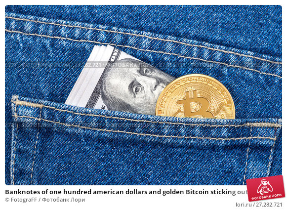 Купить «Banknotes of one hundred american dollars and golden Bitcoin sticking out of the back jeans pocket. Business concept of virtual money», фото № 27282721, снято 11 декабря 2017 г. (c) FotograFF / Фотобанк Лори