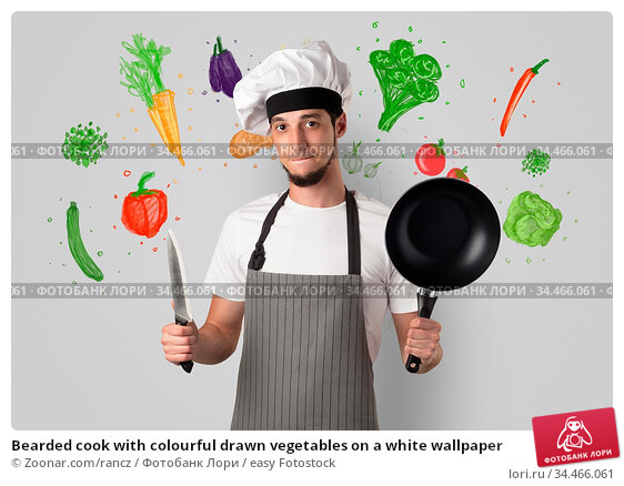 Bearded cook with colourful drawn vegetables on a white wallpaper. Стоковое фото, фотограф Zoonar.com/rancz / easy Fotostock / Фотобанк Лори