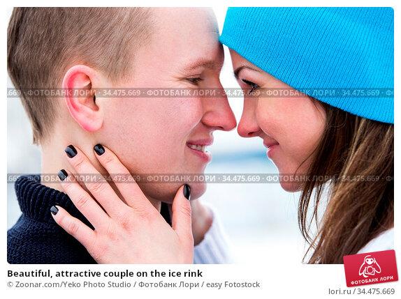 Beautiful, attractive couple on the ice rink. Стоковое фото, фотограф Zoonar.com/Yeko Photo Studio / easy Fotostock / Фотобанк Лори