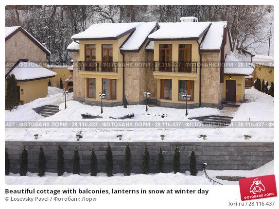 Купить «Beautiful cottage with balconies, lanterns in snow at winter day», фото № 28116437, снято 6 января 2017 г. (c) Losevsky Pavel / Фотобанк Лори